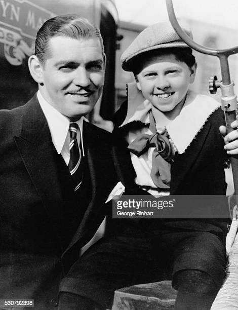Clark Gable poses with Mickey Rooney who played the former as a young boy in the 1937 MGM film Manhattan Melodrama