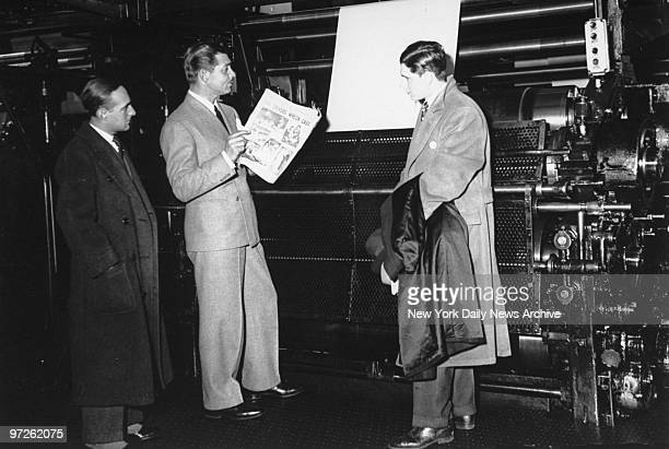 Clark Gable reads the Daily News hot off the press