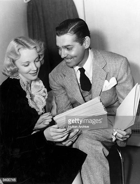 Clark Gable talks to Virginia Bruce the tap dancing beauty and Paramount film star