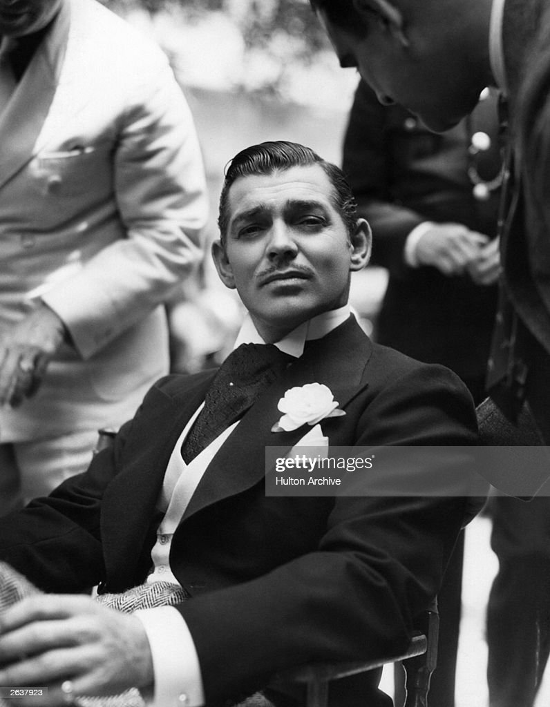 Clark Gable ( 1901 - 1960 ) the American leading man, known as 'The King Of Hollywood' is relaxing between scenes on the set of the film 'Love On The Run'. The movie was directed by W S Van Dyke for MGM.