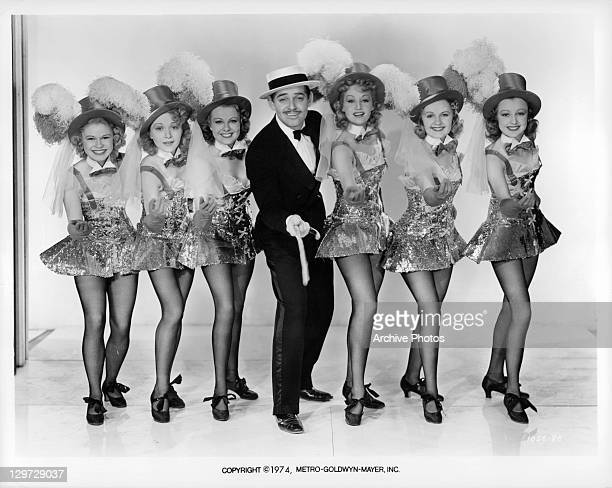Clark Gable with dancing girls in a scene from the film 'Idiot's Delight' 1939