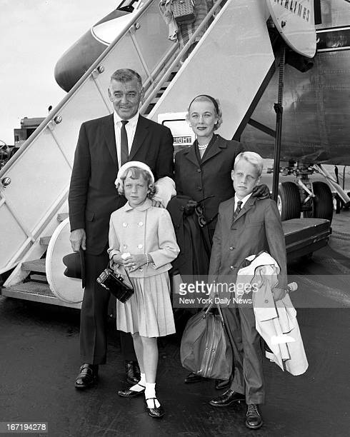 Clark Gable with his wife Kay and children Joan and Adolph arrive at International Airport after flight from Coast They're en route to Italy where...