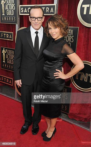 Clark Gregg and Jennifer Grey attend the 20th Annual Screen Actors Guild Awards at The Shrine Auditorium on January 18 2014 in Hollywood California