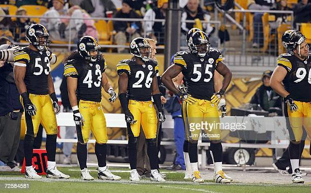 Clark Haggans Troy Polamlau Deshea Townsend and Joey Porter of the Pittsburgh Steelers looks on during the game against the Denver Broncos on...