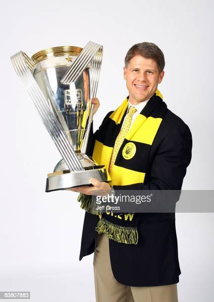 Clark Hunt of the Columbus Crew holds the Philip F Anschutz trophy and poses for a postgame celebration portrait after the Columbus Crew defeated the...
