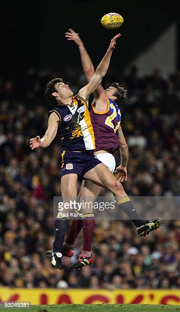 Clark Keating of the Lions contests the ruck against Mark Seaby of the Eagles during the round 16 AFL match between the West Coast Eagles and the...