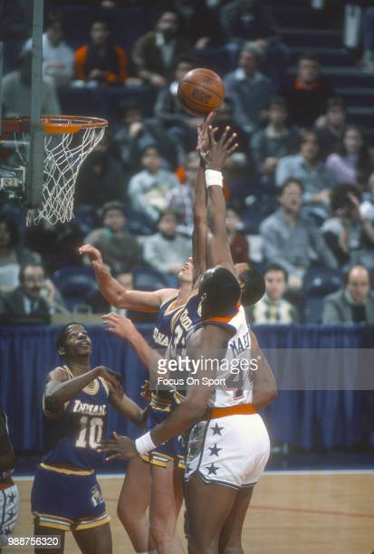Clark Kellogg of the Indiana Pacers battles for a rebound with Rick Mahorn of the Washington Bullets during an NBA basketball game circa 1984 at the...