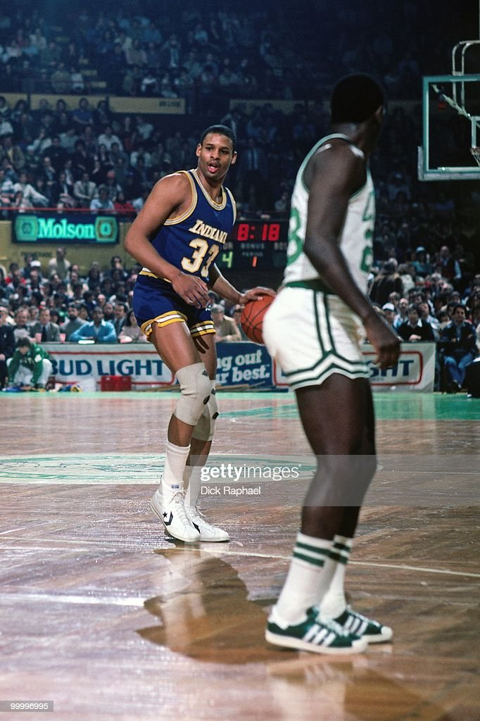 Clark Kellogg #33 of the Indiana Pacers moves the ball up court against the Boston Celtics during a game played in 1983 at the Boston Garden in Boston, Massachusetts.