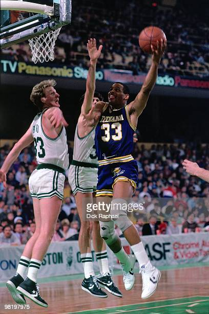 Clark Kellogg of the Indiana Pacers shoots against Larry Bird of the Boston Celtics during a game played in 1985 at the Boston Garden in Boston...