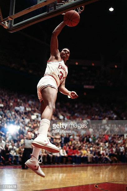 Clark Kellogg of the Ohio State University Buckeyes goes up for a slam dunk during an NCAA game in 1980 at Buckeye Lake Ohio NOTE TO USER User...