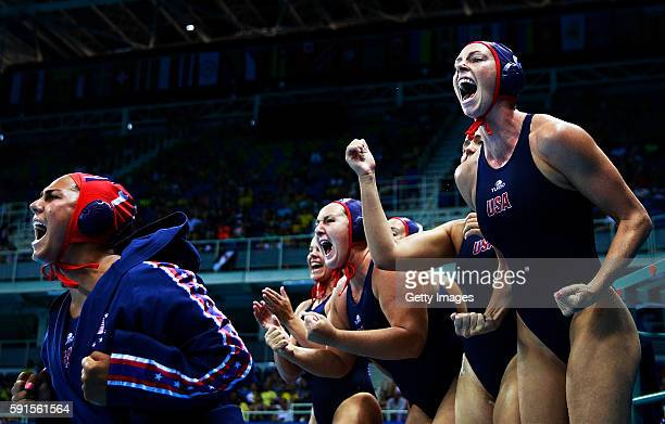 Clark of the USA celebrates a goal with with team mates during the Water Polo semi final match between the USA and Hungary at Olympic Aquatics...