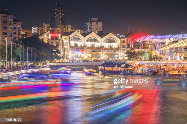 clark quay district wide angle shot singapore's famous view of around marina bay district a popular tourist attraction of singapore. - singapore stock pictures, royalty-free photos & images