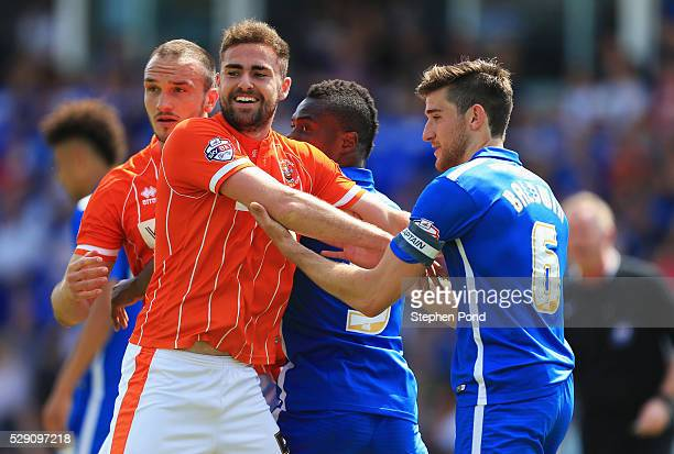 Clark Robertson of Blackpool and Jack Baldwin of Peterborough United tussle at a set piece during the Sky Bet League One match between Peterborough...