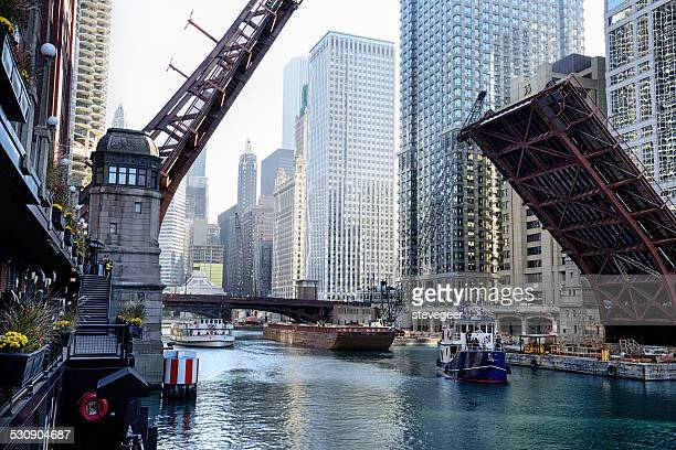 clark street bridge raised over chicago river - barge stock photos and pictures