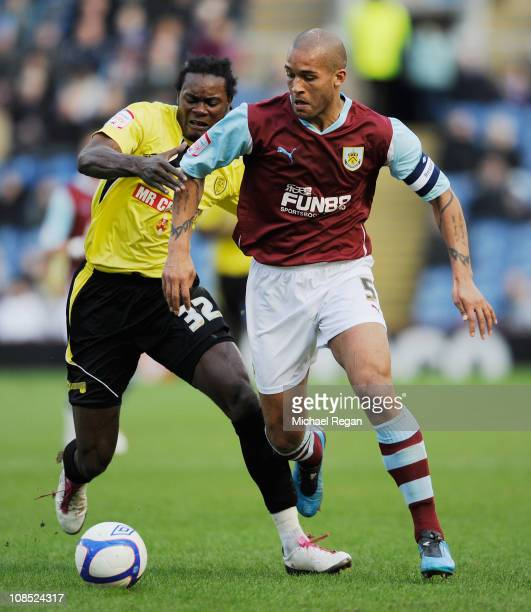 Clarke Carlisle of Burnley in action with Calvin Zola of Burton Albion during the FA Cup sponsored by Eon 4th Round match between Burnley and Burton...