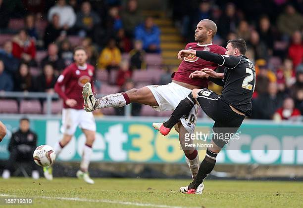 Clarke Carlisle of Northampton Town contests the ball with Craig Reid of Aldershot Town during the npower League Two match between Northampton Town...