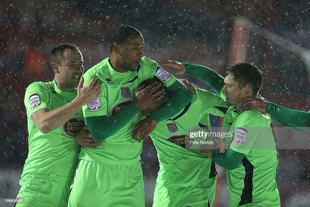 Clarke Carlisle of Northampton Town (2nd right) is congratulated by team mates Kelvin Langmead, Clive Platt and Jake Robinson after scoring his sides 2nd goal during the npower League Two match between Aldershot Town and Northampton Town at the EBB Stadium on January 22, 2013 in Aldershot, England.