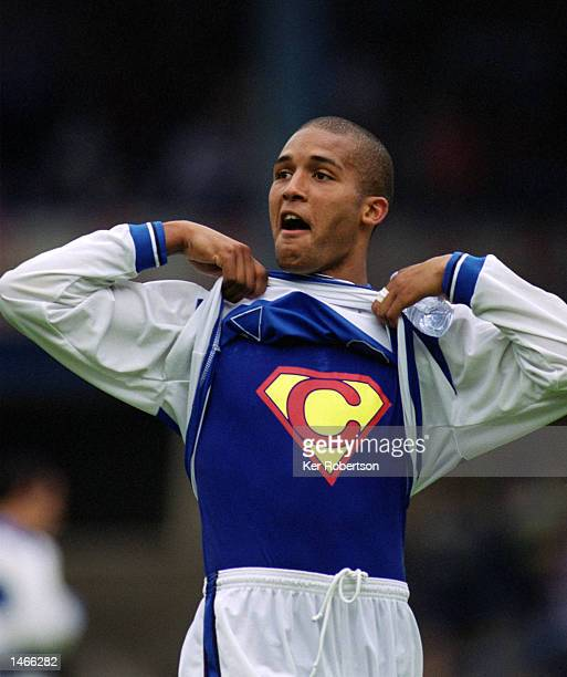 Clarke Carlisle of Queens Park Rangers shows off his Superman tshirt during the Nationwide League Division Two match between Queens Park Rangers and...