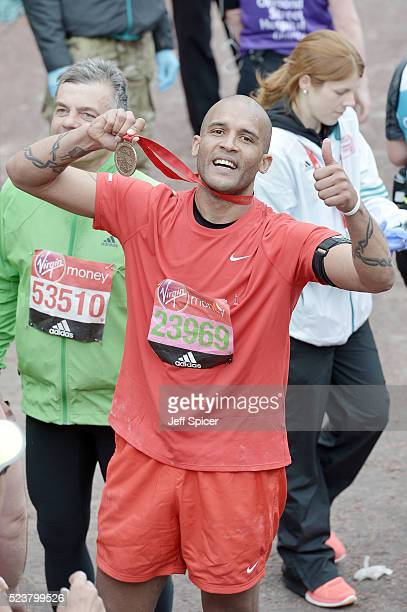 Clarke Carlisle poses with his medal after completing the Virgin Money London Marathon on April 24 2016 in London England