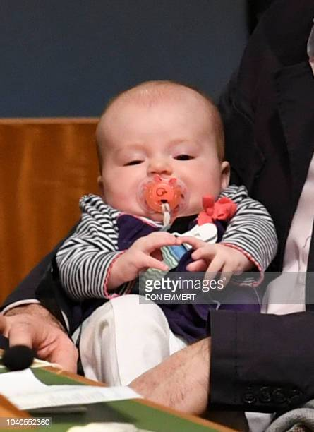 Clarke Gayford looks on holding his daughter Neve Te Aroha Ardern Gayford as his partner Jacinda Ardern Prime Minister and Minister for Arts Culture...