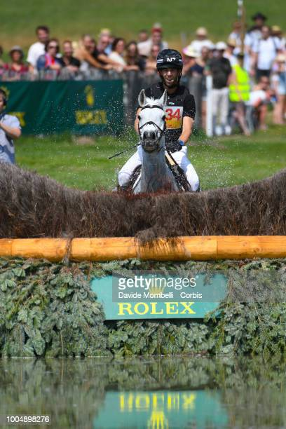Clarke Johnstone of New Zealand riding Balmoral Sensation during the obstacle in the water of the Cross Country test DHLPrize in the park of the CHIO...