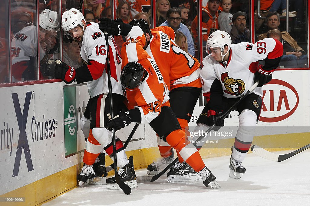 Clarke MacArthur #16 and Mika Zibanejad #93 of the Ottawa Senators battle for control of the puck with Mark Streit #32 and Scott Hartnell #19 of the Philadelphia Flyers at the Wells Fargo Center on November 19, 2013 in Philadelphia, Pennsylvania. The Flyers won 5-2.