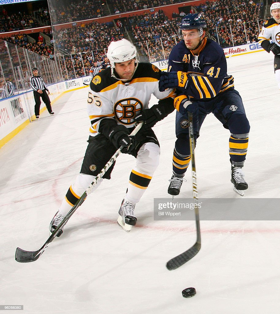 Clarke MacArthur #41 of the Buffalo Sabres battles for the puck against Johnny Boychuk #55 of the Boston Bruins on January 29, 2010 at HSBC Arena in Buffalo, New York.