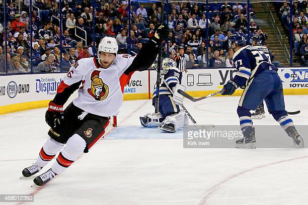 Clarke MacArthur of the Ottawa Senators celebrates after beating Curtis McElhinney of the Columbus Blue Jackets for a goal during the third period on...