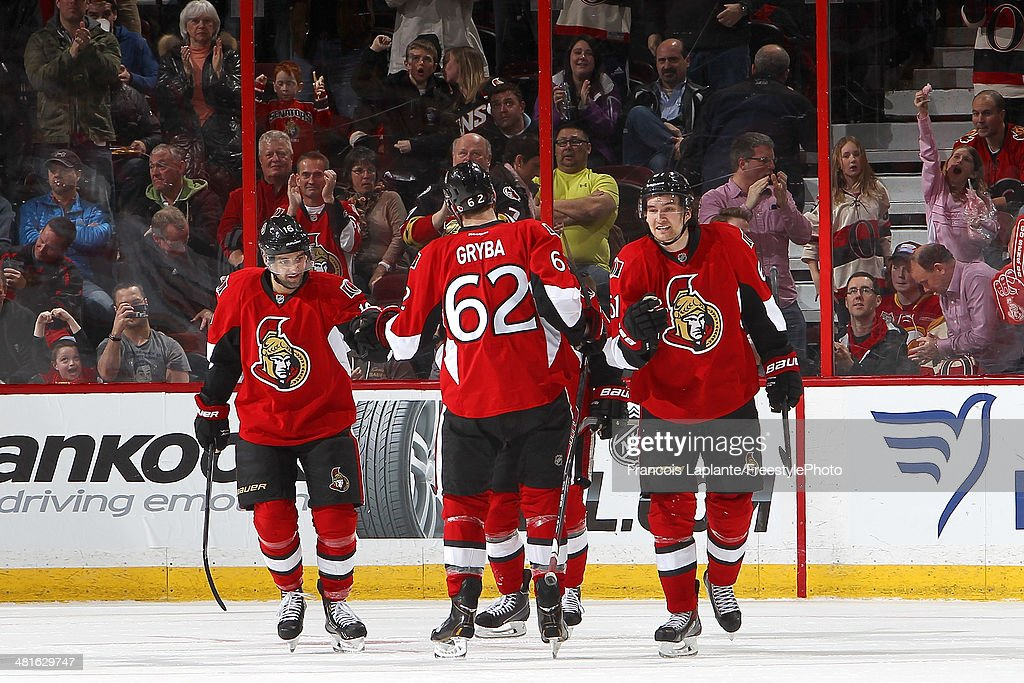 Clarke MacArthur #16 of the Ottawa Senators celebrates his third period goal with teammates Eric Gryba #62 and Mark Stone #61during an NHL game against the Calgary Flames at Canadian Tire Centre on March 30, 2014 in Ottawa, Ontario, Canada.