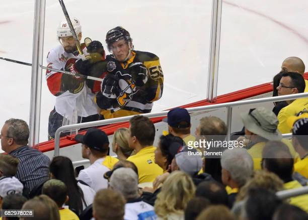 Clarke MacArthur of the Ottawa Senators checks Jake Guentzel of the Pittsburgh Penguins in Game One of the Eastern Conference Final during the 2017...
