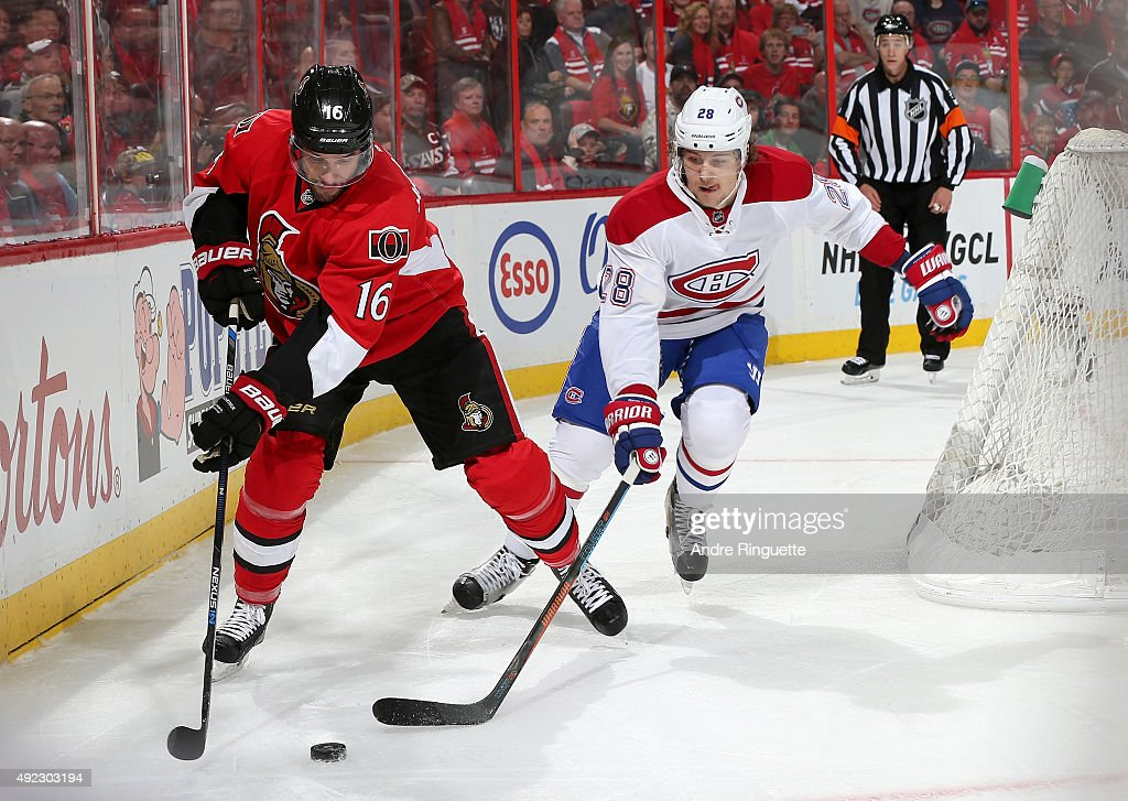 Clarke MacArthur #16 of the Ottawa Senators controls the puck against Nathan Beaulieu #28 of the Montreal Canadiens at Canadian Tire Centre on October 11, 2015 in Ottawa, Ontario, Canada.