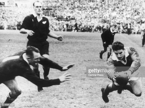 DB Clarke of the New Zealand All Blacks arrives too late to stop British Lions' flyhalf Bev Risman scores the winning try in the final rugby test...