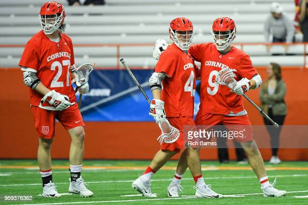 Clarke Petterson of the Cornell Big Red celebrates a goal with teammates Connor Fletcher and Jake McCulloch against the Syracuse Orange during a 2018...