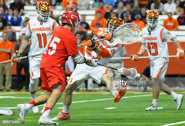 Clarke Petterson of the Cornell Big Red takes a shot around goalie Dom Madonna of the Syracuse Orange during a 2018 NCAA Division I Men's Lacrosse...