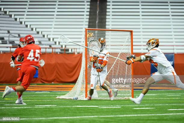 Clarke Petterson of the Cornell Big Red takes a shot on goalie Dom Madonna of the Syracuse Orange during a 2018 NCAA Division I Men's Lacrosse...
