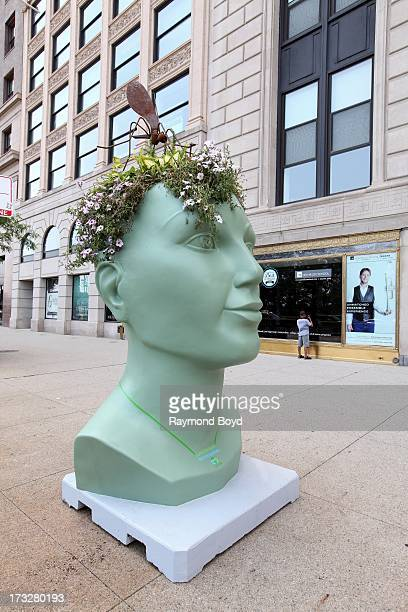 Clarkesponsored lifesized head shaped planter sculpture built from recycled aluminum steel and concrete materials are displayed along the Chicago...