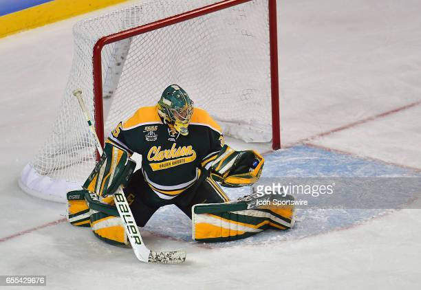 Clarkson goalie Shea Tilly makes a glove save during the Women's Division 1 Hockey Championship between the Wisconsin Badgers and the Clarkson Golden...
