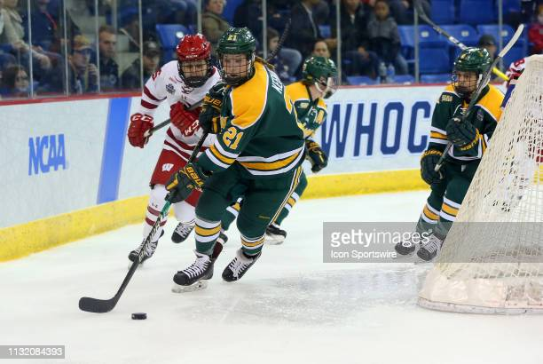 Clarkson Golden Knights defenseman Emma Keenan skates with the puck during the NCAA women's hockey game between Clarkson Golden Knights and Wisconsin...