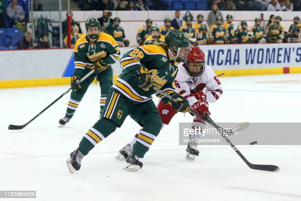 Clarkson Golden Knights defenseman Josiane Pozzebon and Wisconsin Badgers forward Presley Norby in action during the NCAA women's hockey game between...