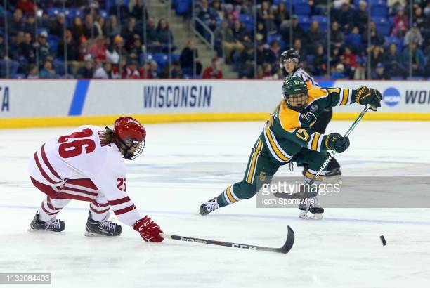 Clarkson Golden Knights defenseman Taylor Turnquist and Wisconsin Badgers forward Emily Clark in action during the NCAA women's hockey game between...