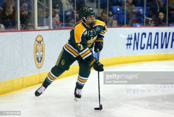 Clarkson Golden Knights defenseman Taylor Turnquist skates with the puck during the NCAA women's hockey game between Clarkson Golden Knights and...