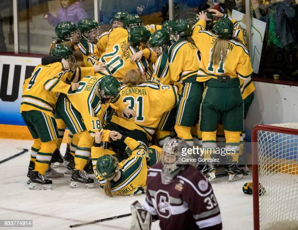 Clarkson University celebrated after a game winning goal in overtime by Elizabeth Giguere during the Division I Women's Ice Hockey Championship held...