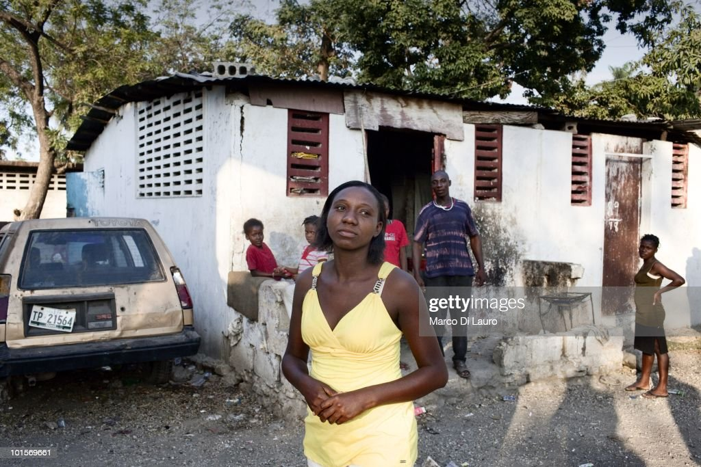 Clarmante Petit Tomb, 26-years-old is seen at her makeshift house in what was a school in a temporary camp on February 2, 2010 in Port Au Prince, Haiti. Clarmante camps in the park next to the National Theatre. She is taking care of five-years-old Johnlee, her niece's brother, not related to her by blood. She has no incomeand worries she will have to put Johnlee into a orphangae if someone doesn't help her to support him. Johnlee is actually malnourished. He rarely smiles. As many as 200,000 people died on January 12 as a consequence of the 7.0-magnitude earthquake. At least 130 people have been pulled alive from the rubble. An estimated 1.5 million people have been left homeless. The Haitian government is planning to relocate some 400,000 people, currently in makeshift camps across the capital, to temporary tent villages outside the city. Aid agencies are still struggling to supply food and water to survivors, while thousands of Haitians who suffered serious injuries remain in need of urgent medical attention.