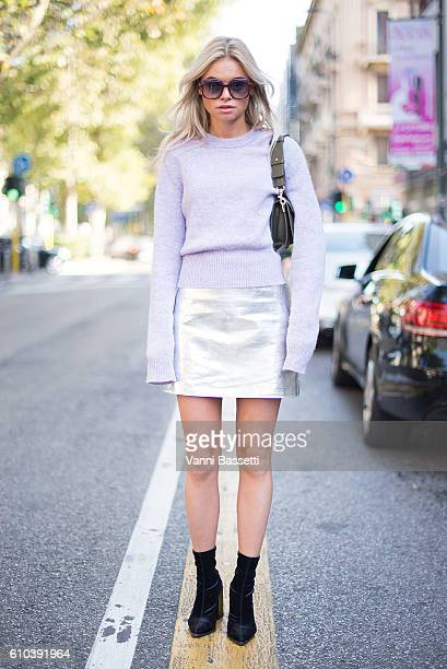 Clartje Rose poses wearing an Acne Studios jumper Zara skirt and JW Anderson bag after the Marni show during Milan Fashion Week Spring/Summer 2017 on...