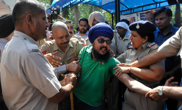 Clash between the protesting students and police during the allparty protest for fee hike outside VC office at Panjab University on April 11 2017 in..