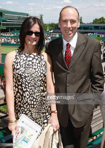 Clash guitarist Mick Jones and wife Miranda arrive as guests of Evian during the Wimbledon Championships 2008 at the All England Club on June 23 2008...