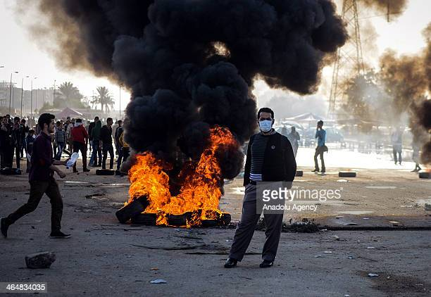 Clashes between anticoup people and Egyptian security forces is ongoing in the Nasr City neighborhood of Cairo Egypt on January 24 2014