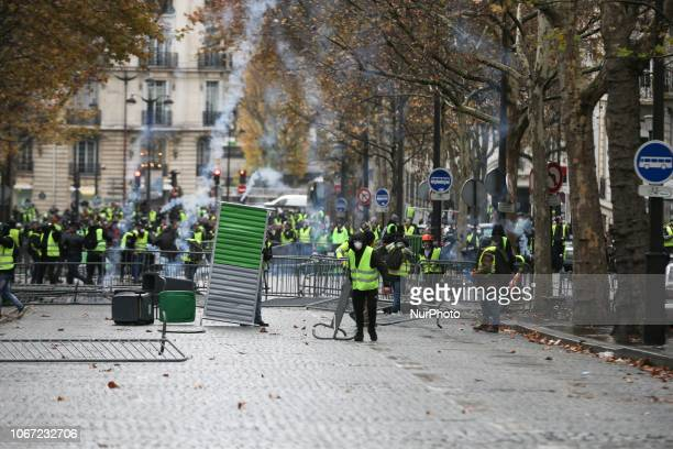 Clashes between demonstrators and riot police in front of the Arc de Triomphe during a protest of Yellow vests against rising oil prices and living...