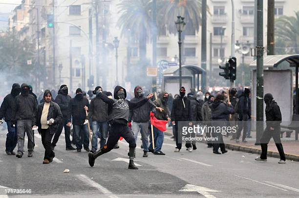 Clashes between police and protesters in Athens city center during the general strike