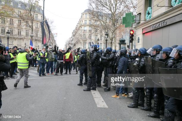 Clashes between protesters and policemen in the Champs Elysées during a demonstration against rising costs of living blamed on high taxes in Paris on...
